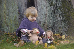 Little toddler in an autumn park Stock Images