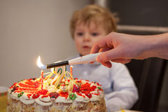 Little toddler blowing candles on his 2 birthday cake Royalty Free Stock Image
