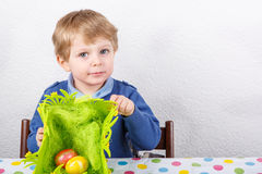 Little toddler boy being happy about selfmade Easter egg Stock Image