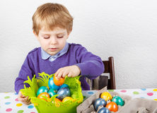 Little toddler boy being happy about selfmade Easter egg Stock Photography