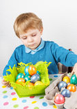 Little toddler boy being happy about selfmade Easter egg Stock Images
