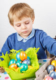 Little toddler boy being happy about selfmade Easter egg Royalty Free Stock Photography