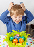 Little toddler boy being happy about selfmade Easter egg Royalty Free Stock Photo