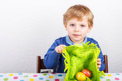 Little toddler boy being happy about selfmade Easter egg Stock Photos