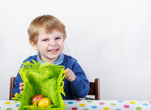 Little toddler boy being happy about selfmade Easter egg in kind Stock Photography