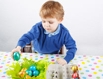 Little toddler boy being happy about selfmade Easter egg in kind Stock Image