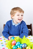 Little toddler boy being happy about selfmade Easter egg in kind Royalty Free Stock Photos