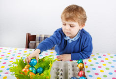 Little toddler boy being happy about selfmade Easter egg in kind Stock Photo