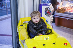 Little toddler boy on car on playground Royalty Free Stock Photography