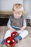 Little toddler boy with Christmas  balls Royalty Free Stock Image