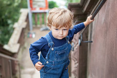Little toddler boy climbing big stairs in city Royalty Free Stock Images