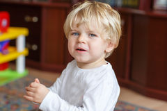 Little toddler boy crying at home indoor Royalty Free Stock Photos