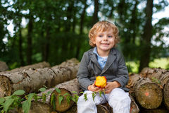 Little toddler boy eating apple in summer forest Royalty Free Stock Images
