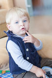 Little toddler boy eating blueberry indoor Royalty Free Stock Image