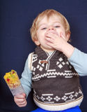 Little toddler boy eating fruit salad in push up cake form. Stock Image