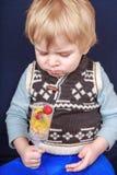 Little toddler boy eating fruit salad in push up cake form. Stock Photo