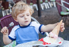 Little toddler boy eating ice cream in summer Royalty Free Stock Photography