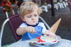 Little toddler boy eating ice cream in summer Royalty Free Stock Images