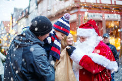 Little toddler boy with father and Santa Claus on Christmas market Royalty Free Stock Image