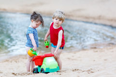 Little toddler boy and girl playing together with sand toys  Royalty Free Stock Image