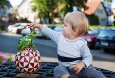 Little toddler boy with handmade toy frog Royalty Free Stock Photography