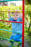 Little toddler boy having fun at a playground Stock Images