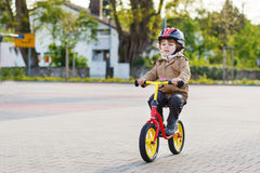 Little toddler boy having fun and riding his bike Stock Image