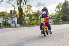 Little toddler boy having fun and riding his bike Royalty Free Stock Photography