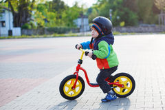 Little toddler boy having fun and riding his bike Royalty Free Stock Images