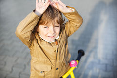 Little toddler boy having fun and riding his bike Stock Photography