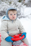 Little toddler boy having fun with snow outdoors on beautiful wi Stock Photo