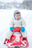 Little toddler boy having fun with snow outdoors on beautiful wi Royalty Free Stock Photos