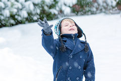 Little toddler boy having fun with snow outdoors on beautiful wi Royalty Free Stock Photography