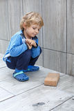 Little toddler boy helping with renovation of home Royalty Free Stock Photography