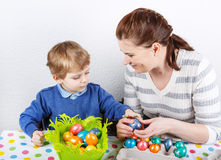 Little toddler boy and his mother being happy about selfmade Eas Stock Photography