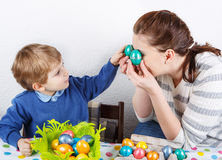 Little toddler boy and his mother being happy about selfmade Eas Royalty Free Stock Photography