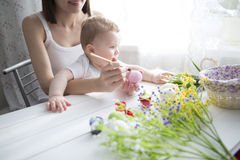 Little toddler boy and his mother decorating Easter egg Stock Image