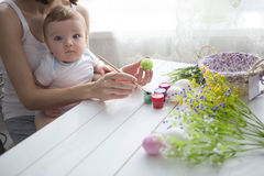 Little toddler boy and his mother decorating Easter egg Stock Photo
