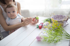 Little toddler boy and his mother decorating Easter egg Royalty Free Stock Photography