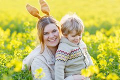 Little toddler boy and his mother in Easter bunny ears having fu Stock Photo