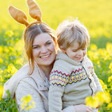 Little toddler boy and his mother in Easter bunny ears having fun Stock Images