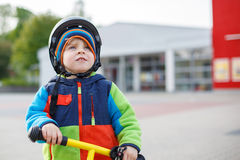 Little toddler boy learning to ride on his first bike Royalty Free Stock Photography