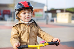 Little toddler boy learning to ride on his first bike Stock Photography