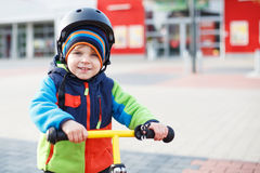 Little toddler boy learning to ride on his first bike Royalty Free Stock Images