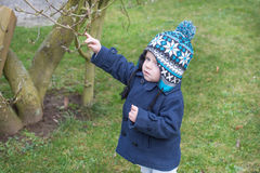 Little toddler boy of one year in spring garden Stock Photos