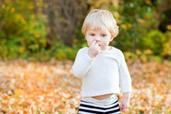 Little toddler boy picking his nose Royalty Free Stock Photo