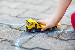 Little toddler boy playing with car toy Stock Photo
