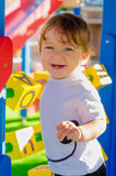 Little toddler boy playing on the playground with cubes. Royalty Free Stock Photography