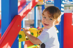 Little toddler boy playing on the playground with cubes. Royalty Free Stock Images