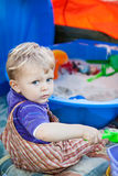 Little toddler boy playing with sand and toy Royalty Free Stock Photography